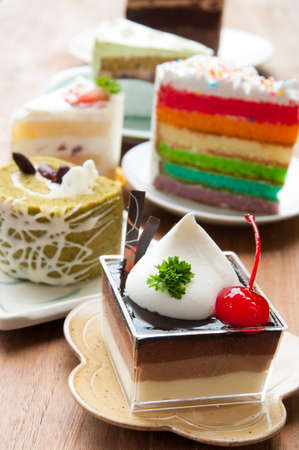 Assortment of pieces of cake, isolated on white photo