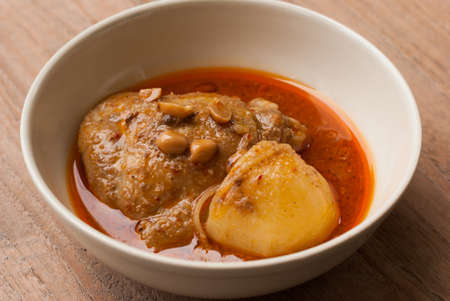 deep focus: Close up Muslim style chicken and potato curry or chicken mussaman curry - deep focus image with path Stock Photo