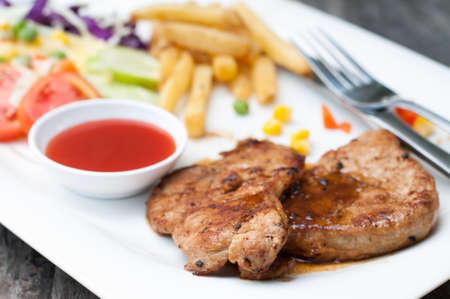 portions: Succulent thick juicy portions of grilled fillet steak served with tomatoes