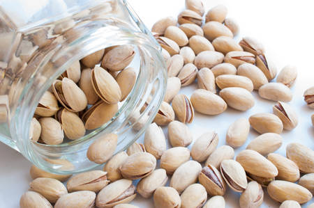 munch: Close up of fresh pistachios.  Stock Photo