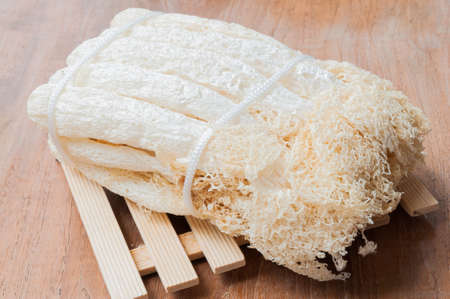 Dried Bamboo mushroom on wooden background.