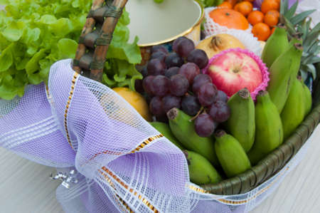 Different fruits and vegetables in basket photo