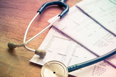 medical exams: stethoscope and laboratory result, Medical insurance concept.