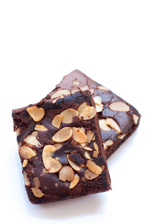 portions: Chocolate brownie portions with almond slice