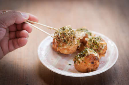 snack time: Takoyaki, delicious Japanese style octopus pancake, topping with multiple seasoning, very famous for snack time.