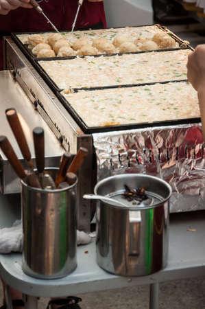takoyaki chefs prepare takoyaki for customers, Takoyaki : Meat balls as Japanese style. photo
