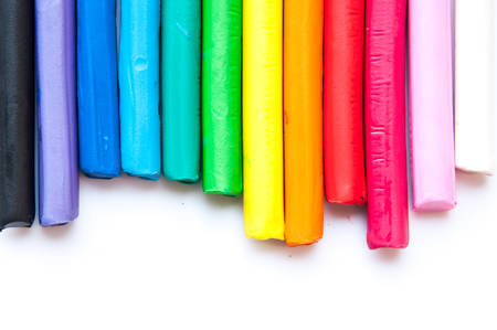 malleable: Rainbow colors plasticine play dough modeling clay isolated over white. Stock Photo