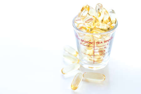 Fish oil capsule isolated on white, health care and medical concept photo
