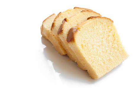 slice of cake: Butter cake sliced white background
