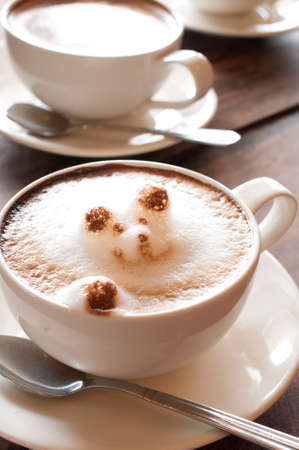 coffeecup: Latte Art CoffeeCup of latte coffee on wooden background Stock Photo