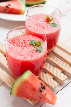 sliced watermelon: Fresh watermelon juice in the glass.Selective focus on the front glass