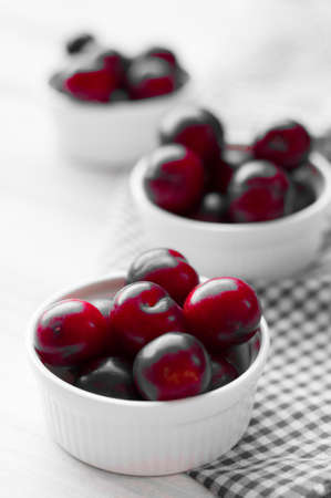 colorize: Sweet plums on wooden background, colorize red Stock Photo