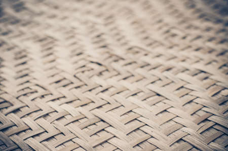 interlinked: Close up detail view of a wicker basket weave with natural materials.