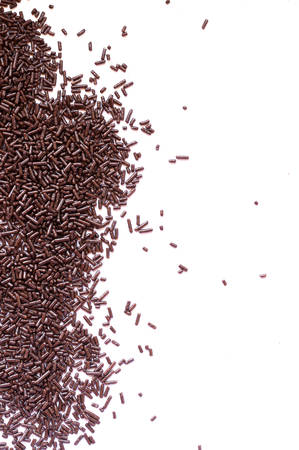 jimmies: Background texture of chocolate sprinkles.