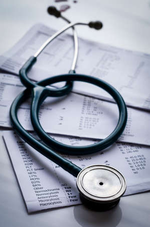 stethoscope and laboratory result, Medical insurance check up, concept. photo