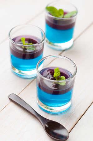 blue hawaiian with blueberry panna cotta dessert on white wooden board photo