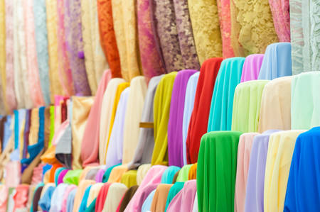 Colorful fabric rolls in the street photo