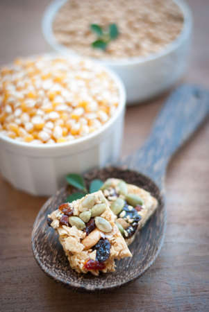 healthy snack: Healthy Snack : Cereal Bars : germinate rice whole grains with fruits on wooden board, Multigrain Bar