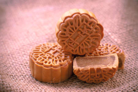 chinese food: Mid-Autumn Festival moon cake on burlap background