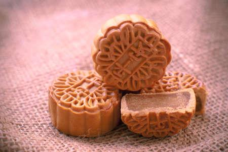 chinese food: Mid-Autumn Festival moon cake on burlap background