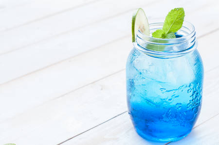 cocktail drinks: cocktail glass with the Blue Hawaii, mason jar