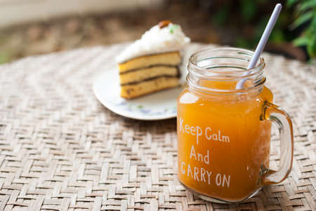 ice tea in mason jar with cake, thai tea