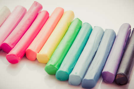malleable: Rainbow colors plasticine play dough modeling clay isolated over white.pastel Stock Photo