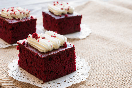 Red velvet cakes on wooden board