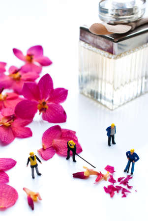 miniature people: alchemy and aromatherapy set with orchid flowers and miniature people Stock Photo