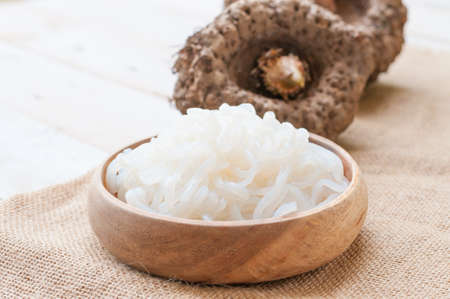 Shirataki noodle, konjac on white wooden board