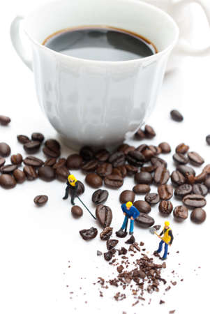 miniature people: coffee beans with miniature people Stock Photo
