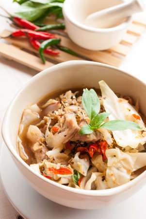 kaeng: North-eastern thai Spicy Soup with Pork, Kaeng Oom on wooden table.