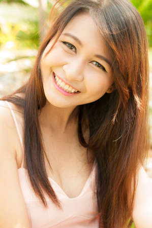 sexy asian woman: fashion indoor photo of beautiful smiling girl, relaxing time