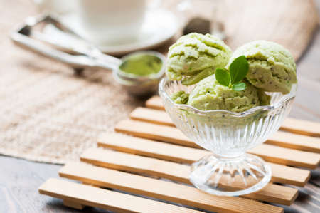 Green Tea Ice Cream on white wood board