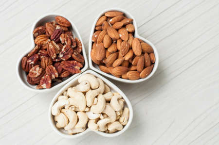 mixed nuts: Assorted nuts in bowl on wooden table