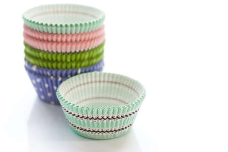 Brightly colored paper baking cups for cupcakes or muffins Stock Photo