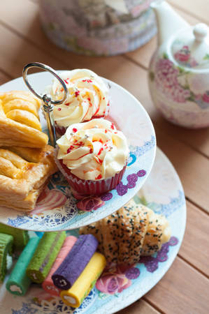 high tea: delicious desserts arranged and served on a cake stand in an english high tea style.