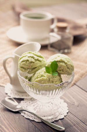 cream and green: Green Tea Ice Cream on white wood board, vintage tone