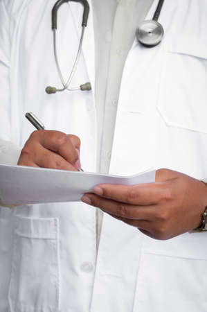 medical team: medical doctor writing on paper Stock Photo