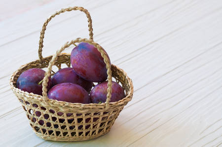 prunes: Fresh prunes in basket