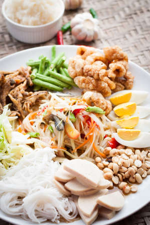 green papaya salad: Green Papaya Salad in tray Stock Photo