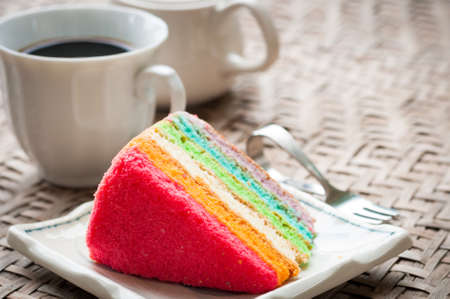 layer cake: Rainbow cake and coffee Stock Photo