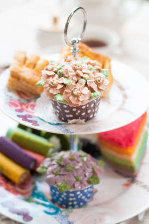 cakestand: delicious desserts arranged and served on a cake stand in an english high tea style