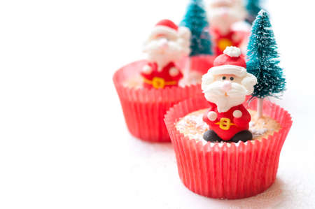 Christmas cup cake on white wooden board 写真素材