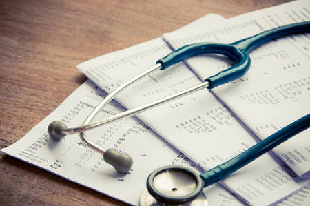 Stethoscope and blood test results Stock Photo