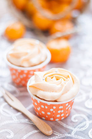 afternoon fancy cake: Orange cupcake on wooden board. Stock Photo