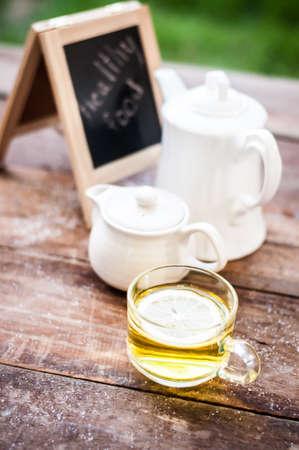 Lemon tea on grunge wooden background Stock Photo