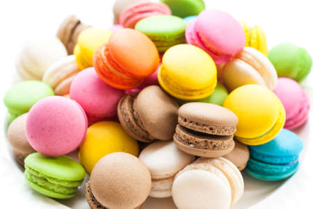 French macaroons. Coffee, chocolate, vanilla and raspberry macaroons, vintage tone Stockfoto