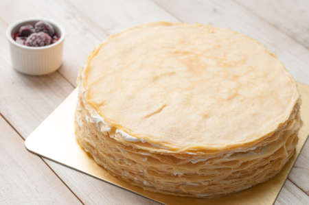 Crepe cake with blackberry sauce