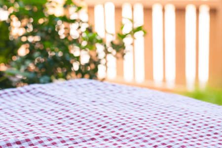 Red checked pattern empty table with bokeh, used for food background